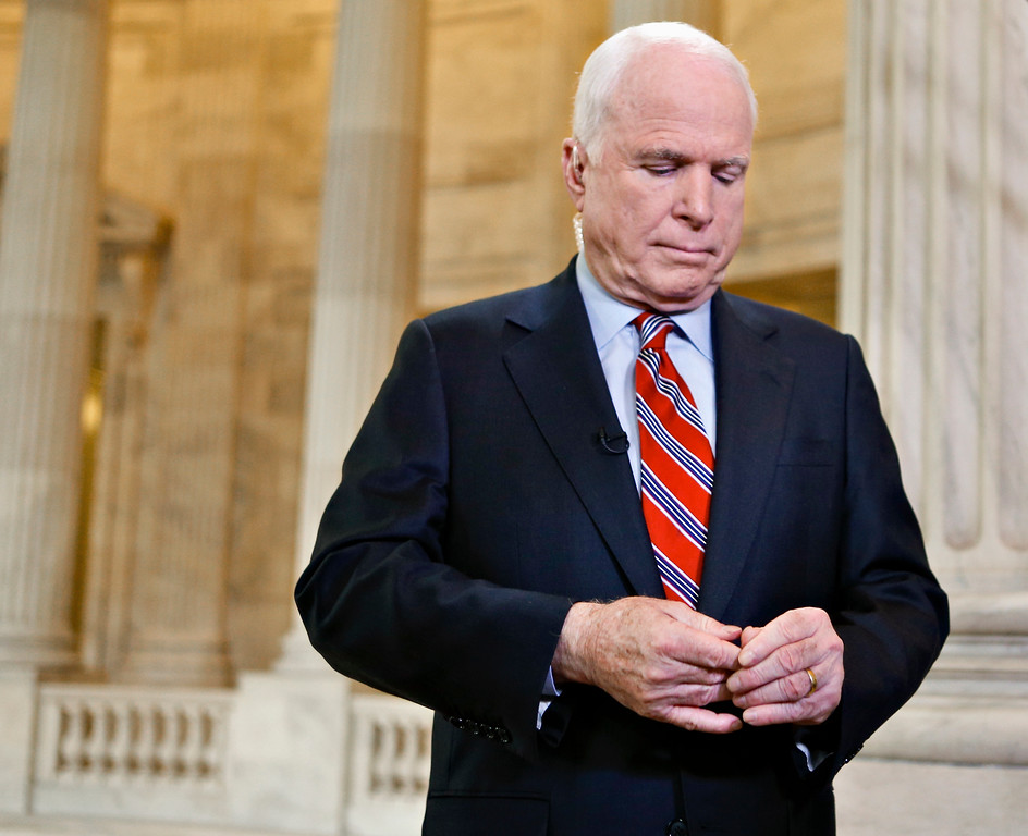 . FILE - In this Sept. 3, 2013 file photo, Sen. John McCain, R-Ariz. pauses during a TV news interview on Capitol Hill in Washington. McCain�s family says the Arizona senator has chosen to discontinue medical treatment for brain cancer.  (AP Photo/J. Scott Applewhite)