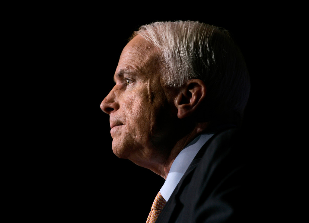 . FILE -- In this Nov. 16, 2006, file photo Sen. John McCain, R-Ariz., pauses while speaking to the GOPAC Fall Charter Meeting in Washington. McCain\'s family said in a statement on Aug. 24, 2018, the Arizona senator has chosen to discontinue medical treatment for brain cancer. The 81-year-old McCain has been away from the Capitol since December. McCain\'s face bears a scar from skin cancer surgery in 2000. (AP Photo/J. Scott Applewhite, file)