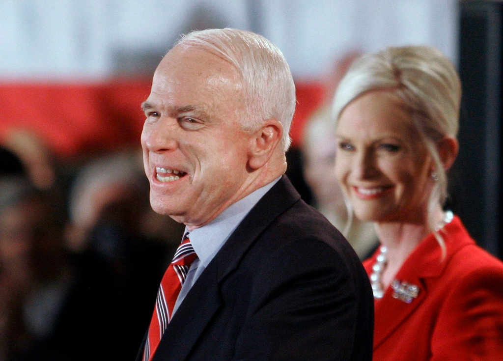 . FILE - In this Jan. 8, 2008 file photo, Republican presidential hopeful Sen. John McCain, R-Ariz., with wife Cindy alongside, addresses supporters on election night in Nashua, N.H.  McCain\'s family says the Arizona senator has chosen to discontinue medical treatment for brain cancer. (AP Photo/Bill Sikes)
