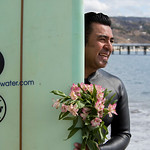 On the morning of Oct. 4, 2015 there was a paddle out memorial for Jim Streeter, the Sun Guru, at Malibu First Point, Malibu, Calif. Rueben Esclante is getting ready to paddle out into the ocean for the memorial service with his bouquet of flowers for the remembrance of Jim. (© Erica Jacques 2015)