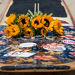 On the morning of Oct. 4, 2015 there was a paddle out memorial for Jim Streeter, the Sun Guru, at Malibu First Point, Malibu, Calif. Jean Pierre Pereat placed a bouquet of sun flowers on his paddle board in remembrance of Jim before paddling out into the ocean. (© Erica Jacques 2015)