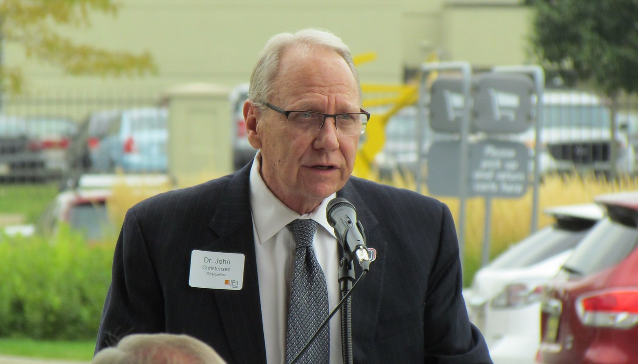 Dr. John Christensen, Chancellor, speaks during Monday's ribbon cutting ceremony.