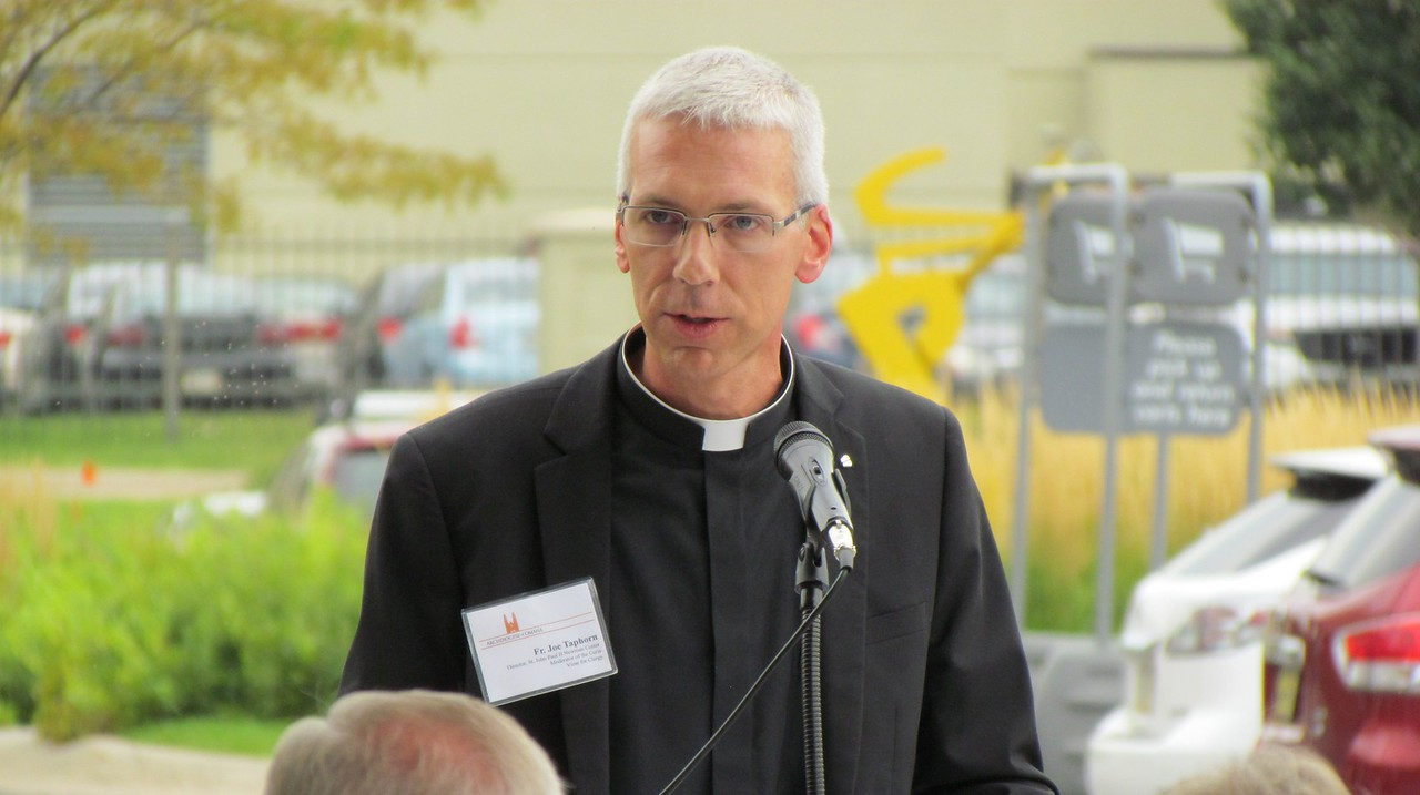 Fr. Joe Taphorn speaks during Monday's 9:30am ribbon cutting ceremony.