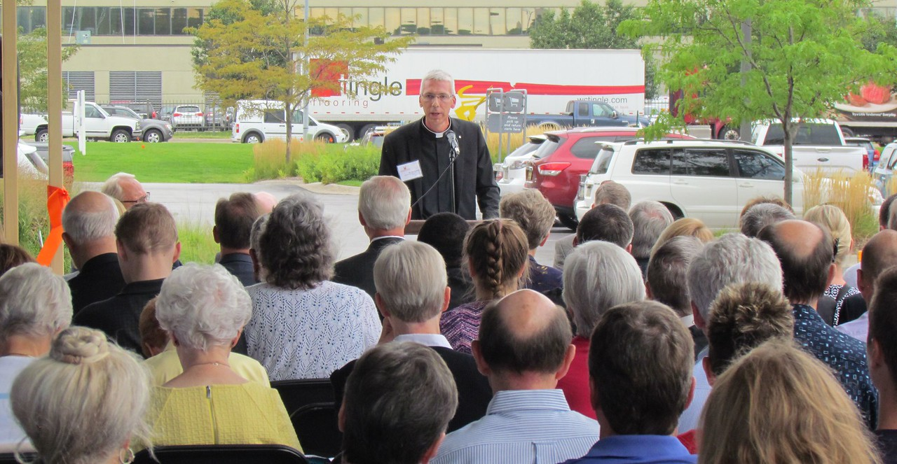 Fr. Joe Taphorn speaks to the attendees of Monday's ribbon cutting ceremony.