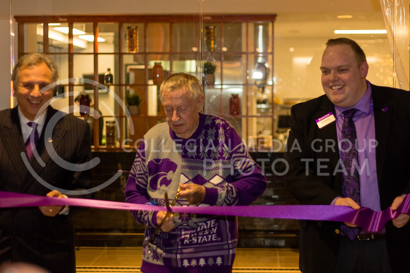 Pat Bosco, John Pence and Jack Ayers Cut the ribbon to Open JP's Union Station on March 1, 2018. (Alex Shaw | Collegian Media Group)