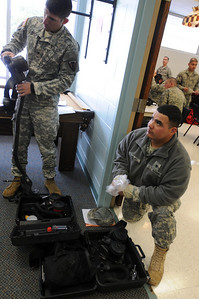 In this image released by the Texas military Forces, Soldiers with 836th Engineer Company have the fit of their powered air purifying respirator (PAPR) masks checked during a lull in operations in Fort Worth, Tuesday, Feb.2 2011. The unit, headquartered in Kingsville, Texas, is in the area with Joint Task Force 71 as part of a mission to support civilian authorities in the weeks leading up to Super Bowl 45. Maintaining equipment readiness ensures the unit will be able to respond rapidly if called upon. (Photo/100th Mobile Public Affairs Detachment, Army National Guard Sgt. Melissa Bright)
