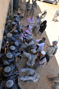 "In this image released by the Texas Military Forces, Soldiers with the 236th Military Police Company conduct riot control operations during Annual Training at Camp Swift, Texas, Wednesday, July 27, 2011. Annual training enables National Guard units like the 236th to maintain their soldiering skills, facilitating them to be ""Always Ready-Always There"". Sustaining proficiency in non-lethal tactics enables success when the unit is called upon to assist civilian authorities as an element of Joint Task Force 71. (Photo/Joint Task Force 71, Army National Guard Spc. Praxedis Pineda)"