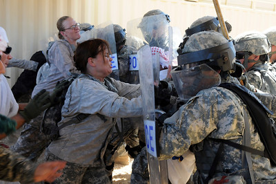 In this image released by the Texas Military Forces, Soldiers with the 236th Military Police Company hold back disgruntled civilians during a training scenario at Camp Swift, Texas, Wednesday, July 27, 2011. As part of the Joint Task Force 71's Annual Training, the MPs spent the day practicing security operations and riot control to support the JTF-71's Homeland Response Force. During a HRF response at an incident, MPs will partner with civilian law enforcement to contain the site and protect against civil disturbances. (Photo/100th Mobile Public Affairs Detachment, Army National Guard Sgt. Suzanne M. Carter)