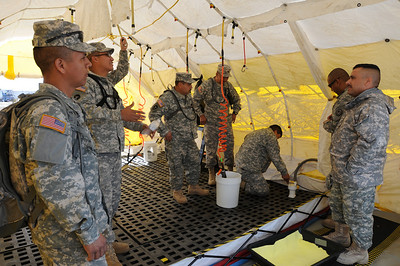 In this image released by the Texas Military Forces, Soldiers from the 436th Chemical Company practice setting up a decontamination site at Fort Wolters, Texas, Thursday, Jan. 27, 2011. The 436th Chem. Co., out of Laredo, is one of several elements of the Texas CRBRNE Battalion Task Force in the Dallas/Fort Worth area as part of a mission in support of Super Bowl 45. Maintaining the skills to set up their equipment quickly enhances the unit's ability to readily deploy when called upon. (Photo/Joint Task Force 71, Army National Guard Sgt. Melissa Bright)