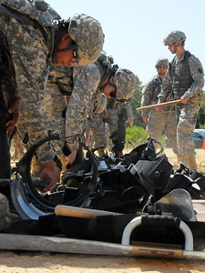 In this image released by the Texas Military Forces, Soldiers with the 236th Military Police Company gear up for a civil disturbance training exercise at Camp Swift, Texas, Wednesday, July 27, 2011. As part of the Joint Task Force 71's Annual Training, the MPs spent the day practicing security operations and riot control to support the JTF-71's Homeland Response Force. During a HRF response at an incident, MPs will partner with civilian law enforcement to contain the site and protect against civil disturbances. (Photo/100th Mobile Public Affairs Detachment, Army National Guard Sgt. Suzanne M. Carter)