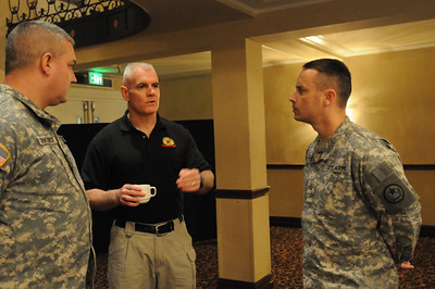 In this image released by the Texas Military Forces, Army Maj. Mikel Sledge and Cpt. Robert Kirkpatrick, with Joint Task Force 71, speak with Marine Col. Peter Ahern, commander of the United States Marine Corps Chemical Biological Incident Response Force, on Tuesday, January 11, 2012 in San Antonio, Texas. Several state and local emergency management organizations came together for a two-day event that began with detailed capabilities briefings and culminated in a tabletop exercise involving a Category-4 tornado touchdown inside San Antonio. The exercise was designed to offer the agencies an opportunity to evaluate current resources, plans and capabilities needed to respond to catastrophic events and ensure a fully integrated and coordinated response if it ever becomes necessary. JTF-71 attendees included several members of the 6th Civil Support Team, 6th Chemical, Biological, Radiological and Nuclear Enhanced Force Package as they are the a part of the FEMA Region VI Homeland Response Force and will be working directly in conjunction with the CBIRF. (Photo/100th Mobile Public Affairs Detachment, Army National Guard Staff Sgt. Melissa Bright)