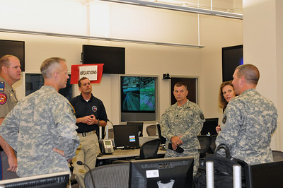 In this image released by the Texas Military Forces,  (left to right) Texas Department of Public Safety Captain Bryan Rippee, Lt. Col. Daniel Quick, Cpt. Michael Torres, Command Sgt. Maj. Horn, Texas Division of Emergency Managemen Regional Liaison Officer Lanita Magee, Col. William Hall discuss Super Bowl 45 in Fort Worth, Thursday, May 19, 2011.  Quick, Torres, Horn and Hall are with Joint Task Force 71, headquartered out of Austin. The task force is comprised of units capable of managing chemical, biological, radiological and nuclear events and is tasked to provide assistance to civil authorities during emergency situations. In the weeks leading to Super Bowl 45, held this year at Cowboys Stadium, Hall, and the units he commands worked tirelessly with multiple local agencies during several record winter storms to ensure success of the event. Additional civil support teams from Utah, New Mexico, Nebraska and Oklahoma were also on hand to provide invaluable assistance.     (Photo/100th Mobile Public Affairs Detachment, Army National Guard Staff Sgt. Melissa Bright)