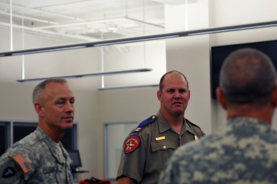 In this image released by the Texas Military Forces, Lt. Col. Daniel Quick, 6th CBRN task Force (left) and Captain Bryan Rippee of the Texas Department of Public Safety (middle)  talk with Col. William Hall, Joint Task Force 71, (right)  in Fort Worth, Thursday, May 19, 2011.  The task force, headquartered out of Austin, is comprised of units capable of managing chemical, biological, radiological and nuclear events and is tasked to provide assistance to civil authorities during emergency situations. In the weeks leading to Super Bowl 45, held this year at Cowboys Stadium, Col. William Hall, JTF-71 senior officer, and the units he commands worked tirelessly with multiple local agencies during several record winter storms to ensure success of the event.  (Photo/100th Mobile Public Affairs Detachment, Army National Guard Staff Sgt. Melissa Bright)