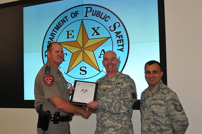 In this image released by the Texas Military Forces, Joint Task Force 71 representatives accept appreciation plaques from Captain Bryan Rippee of the Texas Department of Public Safety in Fort Worth, Thursday, May 19, 2011.  The task force, headquartered out of Austin, is comprised of units capable of managing chemical, biological, radiological and nuclear events and is tasked to provide assistance to civil authorities during emergency situations. In the weeks leading to Super Bowl 45, held this year at Cowboys Stadium, Col. William Hall, JTF-71 senior officer, and the units he commands worked tirelessly with multiple local agencies during several record winter storms to ensure success of the event. Additional civil support team from Utah, New Mexico, Nebraska and Oklahoma provided invaluable assistance and their representatives also received plaques from Rippee.     (Photo/100th Mobile Public Affairs Detachment, Army National Guard Staff Sgt. Melissa Bright)