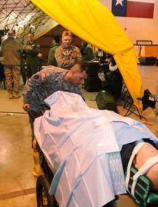 In this image released by the Texas Military Forces, National Guard units conduct small-scale demonstrations, Thursday, Feb. 3, 2011, in Grand Prairie, Texas. The units are part of the region's new Homeland Response Force and used the time to convey their capabilities and readiness to integrate with civil public safety responders. The exhibit included representatives from security, engineering, chemical decontamination and medical assets. (Photo/100th Mobile Public Affairs Detachment, Army National Guard Sgt. Melissa Bright)