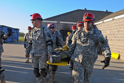 In this image released by Texas Military Forces, Guardsmen with the Joint Task Force 71 support local and civil authorities during the El Campo Memorial Hospital Exercise March 3, 2012. The training event, which simulated several hazardous and first response incidents, tested the alert and response capabilities of the different participating agencies. JTF 71 frequently engages joint and interagency exercises to improve department cooperation and communication.