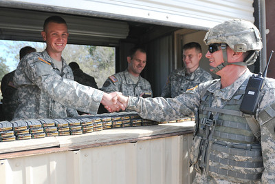 In this image, released by JTF-71 (MEB), Sgt. Daniel Popham of HHC, 636th BSB, receives the brigade sergeant major's coin for outstanding service in readying the M16/M4 qualification range, reallocating resources and vehicles in order to ensure success for the entire brigade. Photo by Sgt. 1st Class Daniel Griego.
