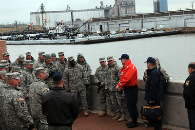 In this image released by the Texas Military Forces, members of Joint Task Force 71 met with the Coast Guard and emergency response organizations during a tour of the Port of Houston Tuesday, December 6, 2011. JTF-71 participated the ship channel tour to continue building relationships with the emergency response agencies responsible for protecting the area.  (Photo/100th Mobile Public Affairs Detachment, Army National Guard Staff Sgt. Melissa Bright)