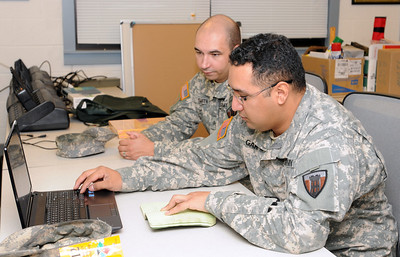 "In this image released by Joint Task Force 71, Guardsmen with the Joint Task Force 71 relocate their offices to the Round Rock Armed Forces Reserve Center as part of their integration with the 136th Manuever Enhancement Brigade in order to better serve the citizens of FEMA Region VI in the event of a natural disaster or terrorist incident. The integration and move, conducted September 17 through 21, will merge the two brigades into a single emergency response outfit, tentatively titled ""Joint Task Force 71 (Manuever Enhancement Brigade)."""