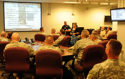 In this image released by the Texas Military Forces, officers and senior noncommissioned officers of Joint Task Force 71 receive an orientation to the Community Emergency Operations Center in Bryan/College Station during Employee Professional Development August 13, 2011. During the visit, they learned how the CEOC can support emergency responders from a safe and secure location, away from the incident site. Bringing the leadership together at an event like EPD ensures that everyone understands the training themes and commander's intent behind them.  (Photo/100th Mobile Public Affairs Detachment, Army National Guard Sgt. Suzanne M. Carter)