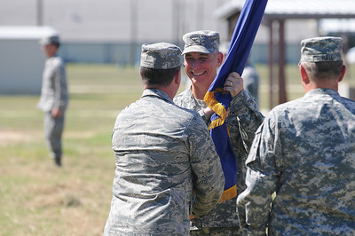 In this image released by the Texas Military Forces, Col. Lee Schnell recieves the Joint Task Force 71 guidon from Maj. Gen. John Nichols, the Adjutant General for the state of Texas during a change of command ceremony in Bryan, Texas, Friday, October 14, 2011. JTF-71 recently completed a National Guard Bureau evaluation for certification as the Homeland Response Force for FEMA Region VI. Outgoing commander, Col. Bill Hall, transferred command to Col. Lee Schnell, his chief of staff for the last twelve months. (Photo/100th Mobile Public Affairs Detachment, Army National Guard SPC Andrew Oeffinger)