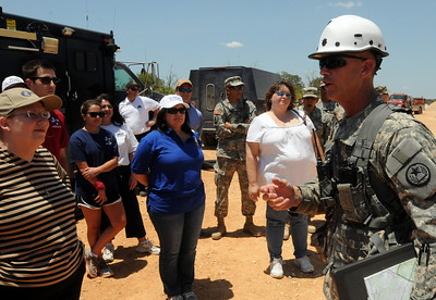 In this image released by the Texas Military Forces, service members' employers observed Joint Task Force 71 participation in a collective training event at Camp Swift, Texas, Thursday, July 28, 2011. In addition to seeing chemical hazard detection, decontamination line set-up, and military police riot control exercises, the visitors had to deal with the extreme heat and harsh conditions while on the installation. The Employer Support of the Guard and Reserve invited employers to see JTF-71's Annual Training to get a better understanding of the demands placed on Citizen-Soldiers. (Photo/100th Mobile Public Affairs Detachment, Army National Guard Sgt. Suzanne M. Carter)