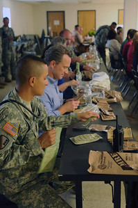 In this image released by the Texas Military Forces, Employer Support of the Guard and Reserve guests receive Meal Ready-to-Eat for lunch during a visit to Camp Swift, Texas, Thursday, July 28, 2011. Employers saw training events such as contamination detection, decontamination line set up, and military police riot control exercises while on the installation. The ESGR invited employers to see Joint Task Force 71's Annual Training to get a better understanding of the Citizen-Soldiers' training periods. (Photo/100th Mobile Public Affairs Detachment, Army National Guard Sgt. Suzanne M. Carter)