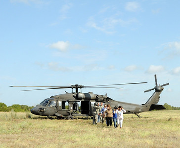 In this image released by the Texas Military Forces, Employer Support of the Guard and Reserve guests arrive at Camp Swift, Texas, on a Blackhawk helicopter Thursday, July 28, 2011. Employers saw training events such as contamination detection, decontamination line set up, and military police riot control exercises. The ESGR invited employers to see Joint Task Force 71's Annual Training to get a better understanding of the Citizen-Soldiers' world. (Photo/100th Mobile Public Affairs Detachment, Army National Guard Sgt. Suzanne M. Carter)