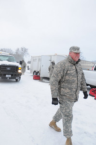 In this image released by the Texas Military Forces, Soldiers with Joint Task Force 71 check essential equipment left outside, place snow-chains on their tires and clear the windshields of ice after a winter storm in Fort Worth, Tuesday, Feb. 1, 2011. JTF 71, headquartered in Austin, Texas, is in the area to support civil authorities during the weeks leading up to Super Bowl 45. Prior to departing for this mission, the units developed strategies to ensure their equipment is ready to deploy in spite of inclement weather. (Photo/100th Mobile Public Affairs Detachment, Army National Guard Sgt. Melissa Bright)