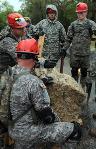 In this image released by the Texas Military Forces, Soldiers with the 836th Engineer Company develop extraction and problem solving skills in College Station, Texas, Sunday, October 9, 2011. The unit participated in the training in preparation for Joint Task Force 71's external evaluation to certify the brigade as a Homeland Response Force. Once certified as a HRF, JTF-71 will be able to partner with civilian organizations in response to natural and man-made chemical, biological, radiological, nuclear and high-yield explosive incidents.  (Photo/100th Mobile Public Affairs Detachment, Army National Guard Sgt. Suzanne Carter)