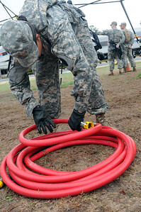 In this image released by the Texas Military Forces, Soldiers with the 436th Chemical Company disassemble its decontamination line in College Station, Texas, Sunday, October 9, 2011. The unit participated in the training in preparation for Joint Task Force 71's external evaluation to certify the brigade as a Homeland Response Force. Once certified as a HRF, JTF-71 will be able to partner with civilian organizations in response to natural and man-made chemical, biological, radiological, nuclear and high-yield explosive incidents.  (Photo/100th Mobile Public Affairs Detachment, Army National Guard Sgt. Suzanne Carter)