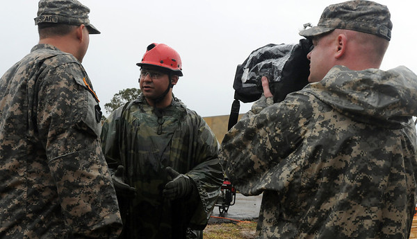 In this image released by the Texas Military Forces, Soldiers with the 100th Mobile Public Affairs Detachment engage Soldiers in interview technique training in College Station, Texas, Sunday, October 9, 2011. The unit participated in the training in preparation for Joint Task Force 71's external evaluation to certify the brigade as a Homeland Response Force. Once certified as a HRF, JTF-71 will be able to partner with civilian organizations in response to natural and man-made chemical, biological, radiological, nuclear and high-yield explosive incidents.  (Photo/100th Mobile Public Affairs Detachment, Army National Guard Sgt. Suzanne Carter)