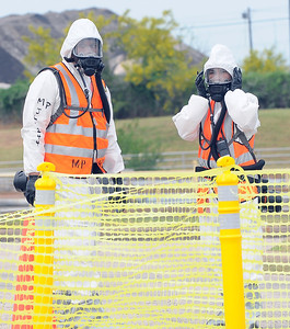 In this image released by the Joint Task Force 71, Servicemembers of the Minuteman Brigade conduct a collective training excercise at the Govalle Water Treatment Facility in Austin, Texas, April 26-27, 2012. This excercise helps Joint Task Force 71 maintain readiness to conduct the Homeland Response Force mission throughout FEMA Region 6.