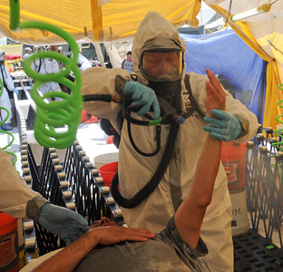 Soldiers from the 436th Chemical Company practice decontamination procedures during a collective training exercise at the Govalle Water Treatment Facility in Austin, Texas, April 26-27, 2012. This exercise helps Joint Task Force 71 maintain readiness to conduct the Homeland Response Force mission throughout FEMA Region 6.