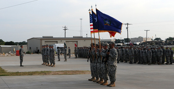 In this image, released by Joint Task Force 71, Soldiers and Airmen of the Minuteman Brigade participate in a change of responsibility ceremony, during which Command Sgt. Maj. Mark Horn relinquished responsibility to incoming brigade CSM, Sgt. Maj. Jeff Mayo. The ceremony, held April 27, 2012 at Camp Swift, Texas, followed the brigade's annual training period which included marksmanship qualification, driver's training and an emergency response exercise.