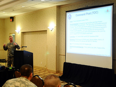 In this image released by the Texas Military Force, Army Col. Lee Schnell, commander for Joint Task Force 71, briefs NGB representatives and commanders during the Homeland Response Force best practices conference and tabletop exercise. The three day event, held in San Antonio January 31 through February 2, featured personnel from the country's 10 Homeland Response Forces discussing lessions learned from the first five validations and planning ahead for the remaining five external evaluations.