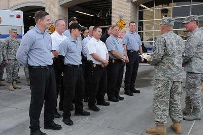 In this image released by the Texas Military Forces, TXMF leadership pauses during support operations to recognize individuals for their contributions in Fort Worth, Texas, Sunday, Feb. 6, 2011. The representatives are from geographically separate unites that include Arkansas' 61st Civil Support Team, Oklahoma's 63rd CST, and Texas' Chemical, Biological, Radiological, Nuclear and Explosives Task Force as well as members of Fort Worth Fire Depatment. The men and women deployed to North Texas as part of a joint training exercise headed by Joint Task Force 71, headquartered out of Austin, Texas, for a two-week Super Bowl 45 support operation.  (Photo/100th Mobile Public Affairs Detachment, Army National Guard Sgt. Melissa Bright)