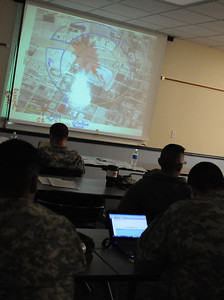In this image released by the Texas Military Forces, Soldiers and Airmen with Joint Task Force 71 participated in command and control training from instructors with Response International Group Thursday, January 12, 2012, at the Round Rock Reserve Center. Attendees included members of the 6th Civil Support Team and 6th Chemical Biological, Radiological and Nuclear Enhanced Force Package, headquartered in Austin. According to Dewayne Torres, one of the instructors, RIG designed the course to allow key leaders within the unit to develop a better understanding of how to use command staff principles for planning the response and site operation through teamwork between units.  (Photo/100th Mobile Public Affairs Detachment, Army National Guard Staff Sgt. Melissa Bright)