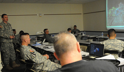 In this image released by the Texas Military Forces, Lt. Daniel Barnhardt explains his mitigation strategy to the Soldiers and Airmen with Joint Task Force 71 as they participated in command and control training Thursday, January 12, 2012, at the Round Rock Reserve Center. Attendees included members of the 6th Civil Support Team and 6th Chemical Biological, Radiological and Nuclear Enhanced Force Package, headquartered in Austin. According to Dewayne Torres of Response International Group, the course to allows key leaders within the unit to develop a better understanding of how to use command staff principles for planning the response and site operation through teamwork between units.  (Photo/100th Mobile Public Affairs Detachment, Army National Guard Staff Sgt. Melissa Bright)