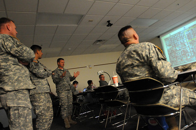 In this image released by the Texas Military Forces, Sgt. First Class William Hobby explains his mitigation strategy to the Soldiers and Airmen with Joint Task Force 71 as they participated in command and control training Thursday, January 12, 2012, at the Round Rock Reserve Center. Attendees included members of the 6th Civil Support Team and 6th Chemical Biological, Radiological and Nuclear Enhanced Force Package, headquartered in Austin. According to Dewayne Torres of Response International Group, the course to allows key leaders within the unit to develop a better understanding of how to use command staff principles for planning the response and site operation through teamwork between units.  (Photo/100th Mobile Public Affairs Detachment, Army National Guard Staff Sgt. Melissa Bright)