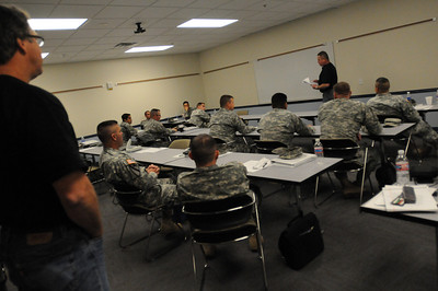 In this image released by the Texas Military Forces, Dewayne Torres address Soldiers and Airmen with Joint Task Force 71 as they participate in command and control training from instructors with Response International Group Thursday, January 12, 2012, at the Round Rock Reserve Center. Attendees included members of the 6th Civil Support Team and 6th Chemical Biological, Radiological and Nuclear Enhanced Force Package, headquartered in Austin. RIG has a long history of providing training designed to allow key leaders within the unit to develop a better understanding of how to use command staff principles for planning the response and site operation through teamwork between units.  (Photo/100th Mobile Public Affairs Detachment, Army National Guard Staff Sgt. Melissa Bright)