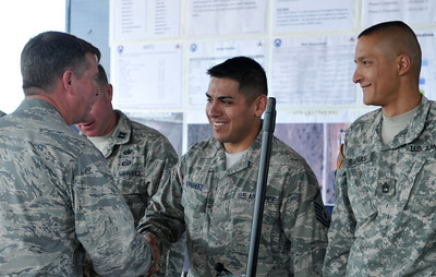 In this image released by the Texas Military Forces, Texas' Adjutang General, Maj. Gen. John Nichols presented coins of excellence to key members of  Joint Task Force 71 during an annual training plan review in Austin, Texas July 9, 2011.  Recipients included Air National Guardsmen Cpt. Harold Hill and Master Sgt. Jesse Hernandez and Army National Guardsmen Sgt. Jahsen Dilger and Sgt. 1st Class Juan Salinas. Representatives were on hand from the 836th Engineers, 436th Chemical Company 236th Military Police and the medical group from the Air National Guard to review their daily plan for completing their upcoming training. Annual Training normally consists of two weeks worth of Soldier Skills training. However, JTF-71 is also using their time on Camp Swift preparing for their external evaluation as a Homeland Response Force in October. (Photo/Joint Task Force 71, Army National Guard Staff Sgt. Melissa Bright)