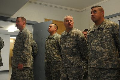 In this image released by the Texas Military Forces, Major General John F. Nichols, Adjutant General of the Texas Military Forces, congratulates the Soldiers and Airmen of the Joint Task Force 71 on a successful completion of a readiness evaluation in Austin Texas, Saturday, December 3, 2011. Service members attached to the JTF-71 completed a rigorous FEMA Region 6 Homeland Response Force External Evaluation. The JTF-71 joined nine other State Homeland Response Forces in the continental US adding technical and tactical capabilities to the emergency response community.    (Photo/100th Mobile Public Affairs Detachment, Army National Guard Sgt. Lamine Zarrad)