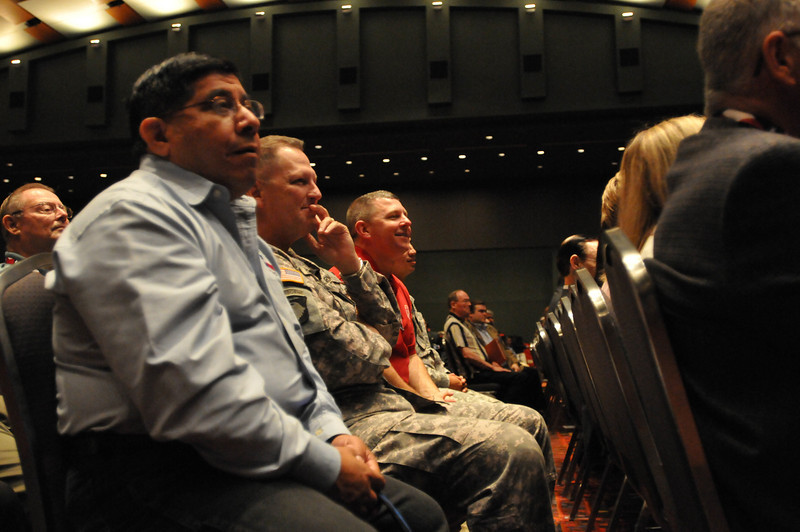 In this image released by the Texas Military Forces, (from left to right) Ruben Alonzo, Col. Patrick Hamilton and Col. William Hall listen to Gov. Rick Perry address attendees of the 2011 Texas Division of Emergency Management Conference, Thursday, April 28, 2011, in San Antonio Texas.  The conference provides the perfect opportunity for members of the Texas Military Forces to meet and interact with key leaders and organization leaders in a non-emergency setting. (Photo/100th Mobile Public Affairs Detachment, Army National Guard Staff Sgt. Melissa Bright)