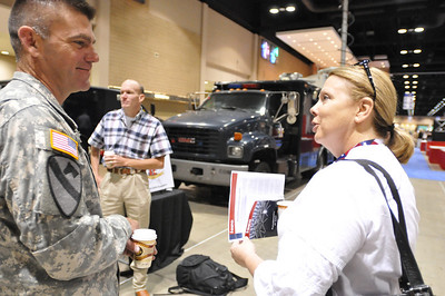 In this image released by the Texas Military Forces, Sgt. 1st Class Anthony Buck speaks with Janet Carrington, of Fayette County Homeland Security Task Force during 2011 Texas Division of Emergency Management Conference, Thursday, April 28, 2011, in San Antonio Texas. Buck is part of the 6th CBRNE, Joint Task Force 71, headquartered in Austin, Texas. The task force is charged with providing defense support to agencies during disasters and other emergencies.  The conference provides the perfect opportunity for the task force members to meet and interact with key leaders and organization leaders in a non-emergency setting. (Photo/100th Mobile Public Affairs Detachment, Army National Guard Staff Sgt. Melissa Bright)