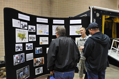 In this image released by the Texas Military Forces, members of Joint Task Force 71 explain what their organization can do during the 2011 Texas Division of Emergency Management Conference, Thursday, April 28, 2011, in San Antonio Texas. The task force is charged with providing defense support to agencies during disasters and other emergencies.  The conference provides the perfect opportunity for task force members to meet and interact with key leaders and organization leaders in a non-emergency setting. (Photo/100th Mobile Public Affairs Detachment, Army National Guard Staff Sgt. Melissa Bright)