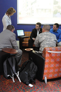 In this image released by the Texas Military Forces, Col. William Hall meets with representatives from the Czech Republic Homeland Response Force during the 2011 Texas Division of Emergency Management Conference, Wednesday, April 27, 2011, in San Antonio Texas. The task forces of both countries are charged with providing defense support to agencies during disasters and other emergencies.  The conference provides the perfect opportunity for Hall, Joint Task Force 71 commander, to meet and interact with key leaders and organization leaders in a non-emergency setting. (Photo/100th Mobile Public Affairs Detachment, Army National Guard Staff Sgt. Melissa Bright)