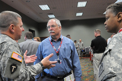 In this image released by the Texas Military Forces, Col. William Hall gives a detailed description of the Joint Task Force 71 during the 2011 Texas Division of Emergency Management, Wednesday, April 27, 2011, in San Antonio Texas. The task force is charged with providing defense support to agencies during disasters and other emergencies.  The conference provides the perfect opportunity for Hall, JTF 71 commander, to meet and interact with key leaders and organization leaders in a non-emergency setting. (Photo/100th Mobile Public Affairs Detachment, Army National Guard Staff Sgt. Melissa Bright)