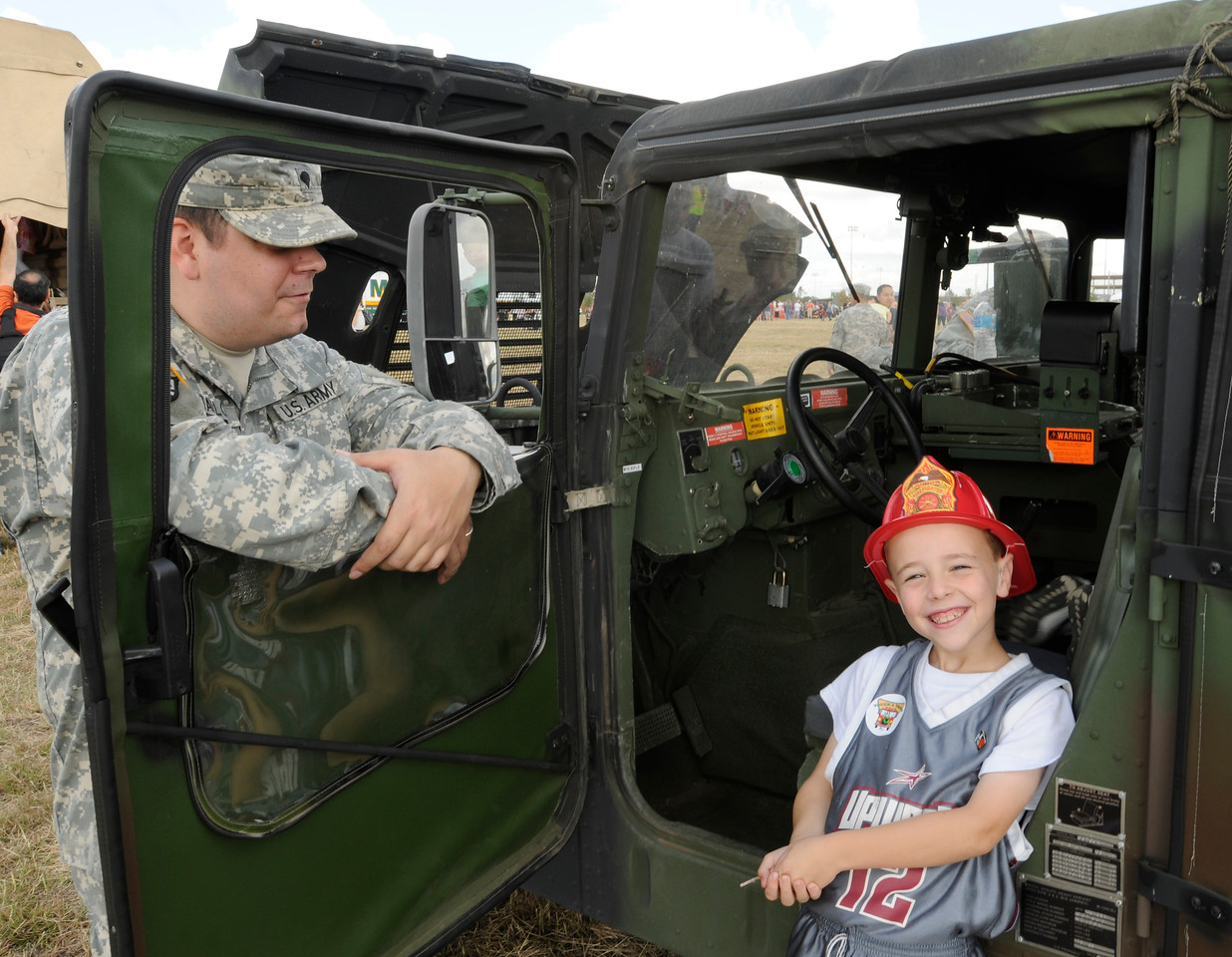 In this image released by Joint Task Force 71 (Maneuver Enhancement Brigade), Soldiers with the Minuteman Brigade participate in Round Rock's Touch a Truck event November 3, 2012, at the Old Settlers Park in Round Rock, Texas. The National Guard was on site for the event to show off and demonstrate Army capabilities and vehicles for the community. The occassion also provided the JTF-71 (MEB) an opportunity to reach out to its new neighbors as the Guard occupants of the new Round Rock Armed Forces Reserve Component Center.