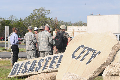 "In this image released by the Texas Military Forces, visiting local law enforcement officials, foreign and domestic military officers and senior enlisted observe the service members of the Joint Task Force 71 participate in an external evaluation at the Disaster City in College Station, Texas, Tuesday, Oct. 11, 2011. The JTF-71 along with several other Texas Guard units have been chosen for the Department of Defense's new ""Homeland Response Force"" program. These units are evaluated on their ability to respond to domestic nuclear, biological and chemical incidents in the FEMA region VI. The HRF program is expected to augment additional resources and capabilities to the emergency response community of Texas. (Photo/100th Mobile Public Affairs Detachment, Army National Guard Sgt. Lamine Zarrad)"